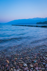 Blue Morning (manypalms) Tags: montana whitefish whitefishlake whitefishbeach lake morning blue smoke forestfiresmoke water stones fujifilmxt1