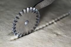 This utensil cuts the dough (for MacroMondays) (cactus2016) Tags: macromondays memberschoicefoundinthekitchen macro kitchen