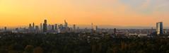IMG_9825_stitch (AndyMc87) Tags: skyline frankfurt sunset hessen rheinmain hennigerturm comerzbanktower messeturm above tree canon eos 6d tamron 70200mm taunus panoramas goetheturm clouds stadt sonnenuntergang himmel baum ezb