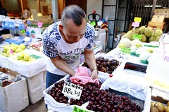 Cherries (superzookeeper) Tags: 5dmk4 5dmkiv hk hongkong canoneos5dmarkiv ef2470mmf28liiusm fruitmarket fruit fruitstall stall cherries shopkeeper people market wetmarket eos digital yaumatei ymt street