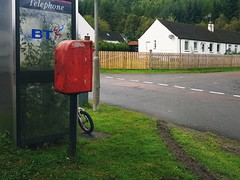 2017-09-14_09-03-04 (35mm disjointed) Tags: skid mark child bike mystery street grass urban overgrown post box telephone royalmail little girl childs bt phone collection fortaugustus