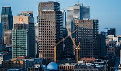 2017 - Montreal - Crossed Cranes (Ted's photos - For Me & You) Tags: 2017 canada cropped montreal nikon nikond750 nikonfx tedmcgrath tedsphotos vignetting cans2s montrealquebec quebec constructioncranes cranes highrise buildings