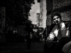 street.portrait.(dappled.light) (grizzleur) Tags: street streetphotography streetportrait candid candidphotography candidportrait candidstreet candidstreetphotography olympusomdem10mkii olympusm45mmf18 dappled light dappledlight highcontrast contrast bw mono monochrome man suit tie bottle drink drinking urban streetlife life style stylish düsseldorf omd omdstreetphotography portrait