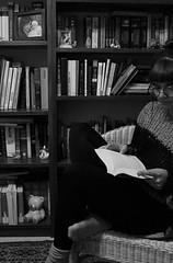 Self portrait - Escape. (giuliabrian) Tags: escape book books reading library bookshelf photos home me cozy girl glasses blackandwhite monocrome