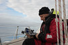 Checking the Sextant (David J. Greer) Tags: norwegian sea adventure travel passage cross crossing sail sailing rubicon3 sailtrainexplore adventuresailing man male person crew sextant looking adjust adjusting cloud clouds cloudy blue sky