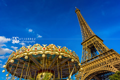 Eiffel Tower and Carousel (II), Paris, France (davidgutierrez.co.uk) Tags: architecture city photography davidgutierrezphotography art urban londonphotographer color paris skyscraper france nikond810 nikon travel people photographer blue eiffeltower toureiffel 巴黎 パリ 파리 париж parís parigi colors colours colour europe beautiful cityscape davidgutierrez capital structure ultrawideangle champdemars afsnikkor1424mmf28ged 1424mm d810 street arts tower carousel pontdiéna riverseine merrygoround summer sunny daytime