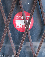 Do Not Enter (Parkguy (David Legg)) Tags: donotenter grate dirtywindow securitydoor red sign closed detroit downtown