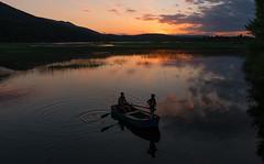 Cerknica Lake (happy.apple) Tags: otok cerknica slovenia si cerkniškojezero cerknicalake slovenija dusk boat fisherman clouds reflection zarja intermittentlake presihajočejezero ribič čoln oblaki