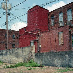 Form, no function -- Yazoo City (ADMurr) Tags: ms yazoo city downtown block rear view red cement brick pole lines wires rolleiflex 28 f kodak mf square 6x6