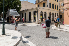 Mexican Standoff (Number Johnny 5) Tags: lines pattern d750 2470mm decisive street people holiday light man candid woman photographers town shadow tamron angles corfu