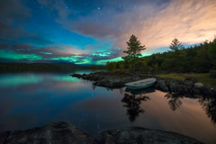 Charge (lonekheir) Tags: aurora northernlights green forest hills