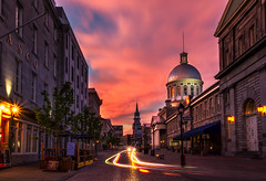 Fire in the sky over old town Montreal (jenni 101) Tags: sunset canada le montreal oldmontreal architecture lighttrails longexposure quebec