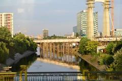 Tram ride through Bucharest - Cityscape (fdlscrmn) Tags: reflection motion buildings river bridge cityscape bucharest trees 7dwf