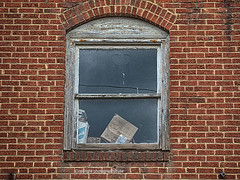 Old Books and Boxes (Photographybyjw) Tags: old books boxes very worn weathered window surrounded by red brick found an almost abandoned building north carolina grit grimes rural country usa small town
