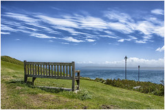 finally I met the sea  ... (miriam ulivi (away for two weeks )) Tags: miriamulivi nikond7200 england cornwall stives mare sea cielo sky nuvole clouds panchina bench prato meadow lampioni lamps