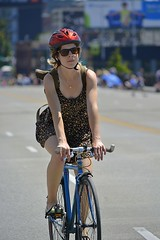 Rider (swong95765) Tags: woman bicycle cyclist ride riding street dress helmet
