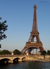 Eiffel Tower beside river and bridge
