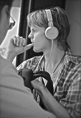 In Oslo, Norway (JasChamPhoto) Tags: norwegian pensive headphones monochrome blond portrait profile passenger publictransit norway oslo candid man male guy dude peachfuzz plaid backpack