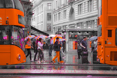 High Summer Oxford Street (stellagrimsdale) Tags: processed sunday sliders photoshop overprocessed rain rainy london bus red patriotism unionjack buses umbrella umbrellas street oxfordstreet pavement sidewalk effects canon 50mm hss