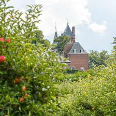 Castle in Orchard (enneafive) Tags: hulsbergcastle borgloon limburg belgium orchard apples agriculture nature green trees fruit fujifilm xt2 clouds sky building architecture bucolic