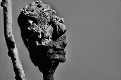 Man holding up right arm (Phancurio) Tags: iron sculpture eleniohara