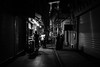 time for a late snack / small islands of light and life (Özgür Gürgey) Tags: 2017 20mm bw d750 darkcity nikon sirkeci voigtländer evening late light lowlight people shadows shop snack street istanbul alley