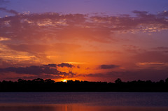 Sunset Over A Florida Lake (radiorocky) Tags: sunset clouds sky lake water sun red orange blue florida tropical fortpierce pentax k3ii pentaxflickraward