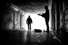 bear pit busker (Daz Smith) Tags: dazsmith fujixt20 fuji xt20 andwhite bath city streetphotography people candid portrait citylife thecity urban streets uk monochrome blancoynegro blackandwhite mono guitar busker music musician performer silhoiuette tunnel subway graffiti bristol