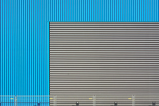Blue and grey wall and fence