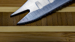 Knife on Cutting Board (robsfrederick) Tags: macromondays memberschoicefoundinthekitchen cuttingboard knife bamboo wood macro closeup canon 80d sigma1835mmf18art
