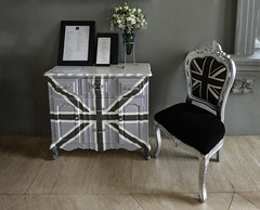 At the Flutes Restaurant (Steve Taylor (Photography)) Tags: flutes restaurant unionjack chestofdrawers vase menu flag tiles art architecture chair muted black white green grey brown asia city singapore flower bouquet nationalmuseumofsingapore british cupboard
