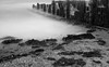 Criccieth Groin (alan.dphotos) Tags: criccieth groins groin sand sea waves tide tides rocks rock seaweed blackand white