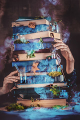 A pile of magical books with wizard hands. (Dina Belenko) Tags: art artist author autumn black book collection concept conceptual copywriting creativity dark desk editing education enchanted fairytale hand idea imagination information learning literature magic mystery object page paper poet reader religion research scary science shelf smoke spiritual spirituality stationary stilllife study text wisdom witch work workplace write writer writing