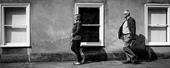 2 steps behind (phil anker) Tags: people street mono salisbury fujix70