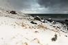 Nwards view Ytresand-Sandbotnen bay along Roren mount-Moskenesoya. Bjorntinden-Gauktinden-Knubban mounts-Flakstadoya. Lofoten-Norway. 0402 (rweisswald) Tags: coast bay beach seaside rockyshore seashore cove inlet bight ytresand yttersand fredvang sandbotnen sandoya view landscape seascape white snowy snowfall snowblanket snowcovered snowcappedmountain storm stormysky cloudy overcast misty darkwater sea wave wood wooden cottage rorbu hut cabin seahouse porch peak roren moskenesoya montinden bjorntinden gauktinden knubban flakstadoya lofoten nordlandfylke norway
