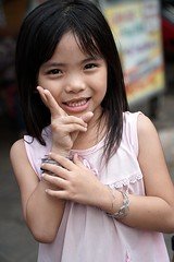 A cute little Vietnamese girl, Can Tho, Vietnam (adamba100) Tags: asia asian china chinese korea korean mongolia mongolian vietnam vietnamese thai beijing town city view landscape cityscape street life lifestyle style people human person man men woman women male female girl boy child children kid interesting portrait innocent cute charm pretty beauty beautiful innocence play face headshot pure purity tourism sightseeing tourist travel trip light color colour outdoor traditional cambodia cambodian phnom penh sony a6300 18105 siem reap pattaya bangkok field gate architecture bike