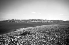Pag Island, Croatia. (wojszyca) Tags: contax g2 zeiss biogon 21mm adox cms 20 adotech landscape sea rock mountains sky pag island croatia