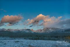 The rising sun starts to illuminate the mountains