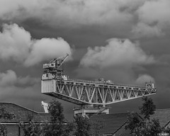 Crane In The Clouds (whistlingtent) Tags: crane clouds newcastleupontyne hammerhead houses rooftops sky industrial urban angleanglesangles
