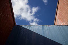 Composition of Lines and Clouds (Giovanni Cappiello   f.64) Tags: blue decay urban wall concrete rough sky brown city rome morning abstract watermark white architecture bricks roma italia ita