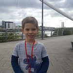 George and his medal for finishing his first full parkrun
