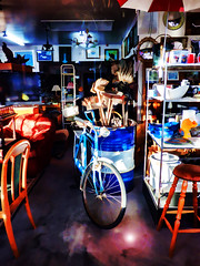 I'm Just Browsing This Universe (Steve Taylor (Photography)) Tags: sun universe barrel umbrella mirror stool stand shelving bowl settee pot art digital chair lamp light shop newzealand nz southisland canterbury christchurch broom cups dish junkshop lid plate wheel bike bicycle cycle