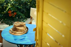 Day 243 : Is for ... The Last Day Of Summer (Storyteller.....) Tags: day last summer greece island vacation window table hat flowers blue green red yellow chair balcony 365 deep365 nikon