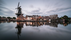 Catch the Wind (McQuaide Photography) Tags: haarlem noordholland northholland netherlands nederland holland dutch europe sony a7rii ilce7rm2 alpha mirrorless 1635mm sonyzeiss zeiss variotessar fullframe mcquaidephotography adobe photoshop lightroom tripod manfrotto light licht availablelight water reflection longexposure stad city urban river spaarne rivier waterside lowlight outdoor outside waterfront architecture skyline building gebouw wideangle wideanglelens groothoek windmill molen molendeadriaan scheepmakerskwartier calm peaceful tranquil landmark nd ndfilter neutraldensity bwfilters