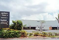 Cutler Ridge Mall after Hurricane Andrew (StevenM_61) Tags: storm hurricane disaster shoppingmall sign parkinglot trailer shrubs trees 1992 cutlerridge cutlerbay florida unitedstates