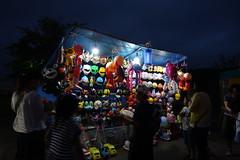 Masks for Sale (sjrankin) Tags: 5august2017 edited yubari hokkaido japan people yubarisummerfestival yubarinatsumatsuri shimizusawa stall toy mask night