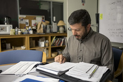 0830 Gary looks at his stack of notes during a meeting