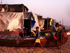 Shack life (Namita Pawah) Tags: shack slum mumbai beaches versova children boat sunset tones evening kids people