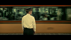 Nara Line, Kyoto, Japan (emrecift) Tags: candid portrait night street photography kyoto japan train subway station guard slow shutter motion cinematic 2391 anamorphic crop sony a7 alpha legacy lens glass canon new fd 35mm f28 emrecift
