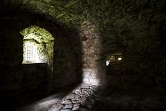 "turn around, a shaft of light shows the door is open, Tolquhon Castle, Aberdeenshire, Scotland (grumpybaldprof) Tags: canon 7d ""canon7d"" sigma 1020 1020mm f456 ""sigma1020mmf456dchsm"" aberdeenshire scotland ""tolquhoncastle"" tolquhoun pitmedden castle stone chateau renaissance ""preston'stower"" forbes colour hdr rock light sunshine dark negativespace muskethole warm mood hope"